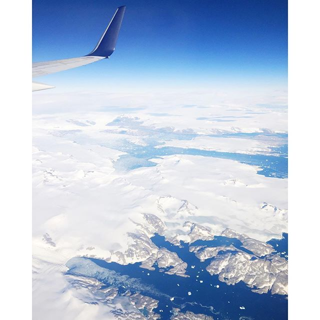 ✈️ the captain announced this is a rare view above greenland - stunning snow covered mountains and icebergs! /