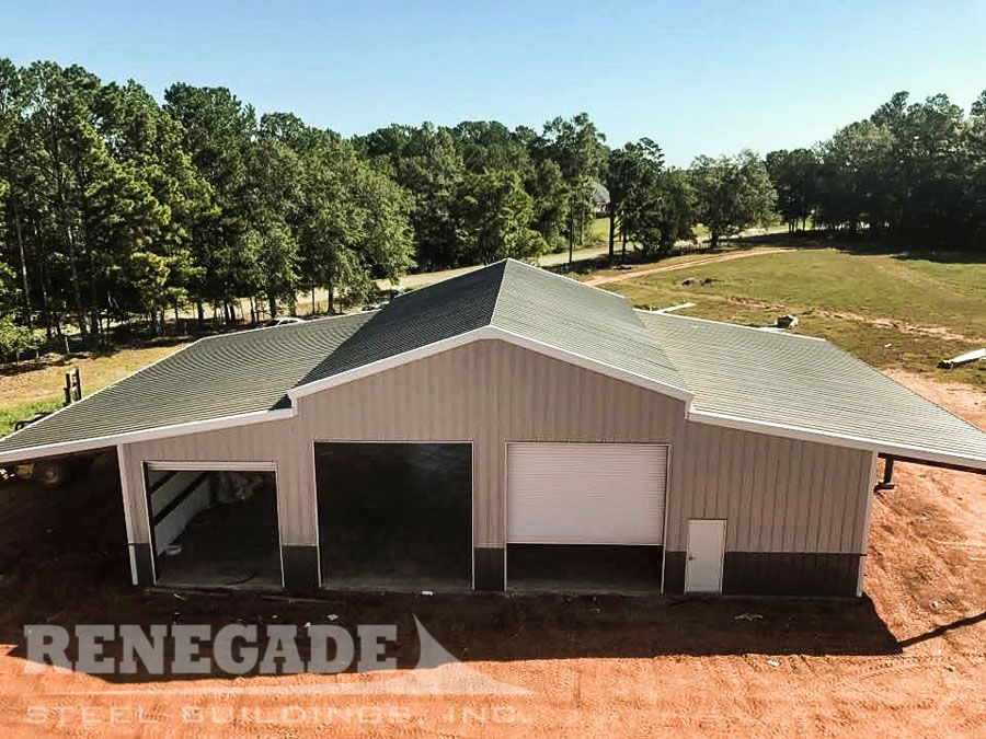 Metal Building With Barn Style Roof Line Open Lean To On Each Side Large Roll Up Doors On Each End T Steel Buildings Metal Buildings Pre Engineered Buildings