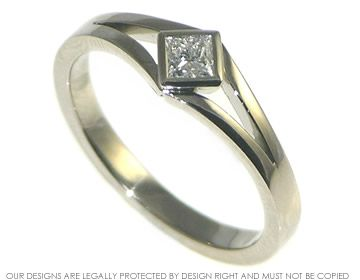 This bespoke engagement ring was inspired by one of our ready to wear engagement rings. The band is made of fairly traded 18ct white gold and measures approximately 2.5mm wide at the sides. The central 3.5mm (0.23ct) H Si princess cut diamond has been set on its points in an all round 18ct fairly traded white gold setting. The ring is finished to a high polish. Sarah also had a ring designed at the same time, including the split band and princess cut diamond but giving a very different look.