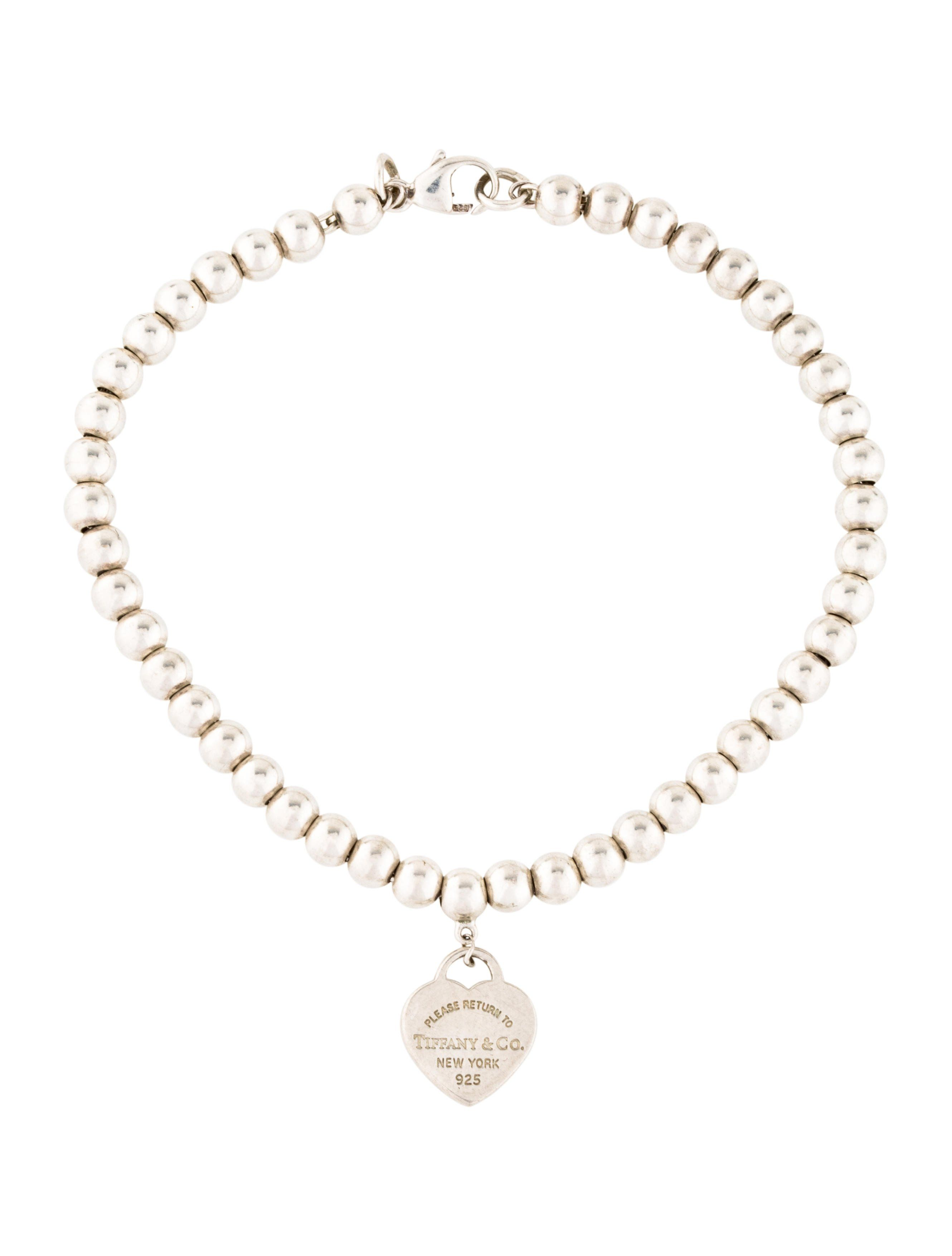 7e14e6c81 Sterling silver Tiffany & Co. Return To Tiffany bead bracelet featuring a  fixed designer engraved heart charm and lobster clasp closure.