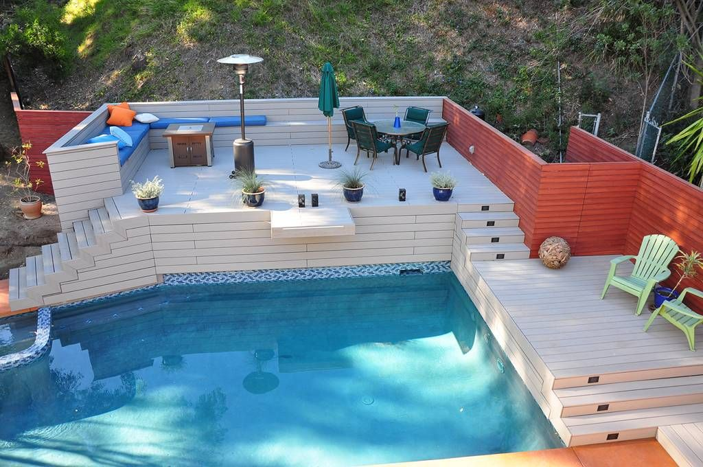 Utilizing The Pool Decks For Relaxing Antique Outdoor Lamp Feats Two Toned Painted Fence Plus Cool Pool Deck And Corner Bench Seat Piscinas Living