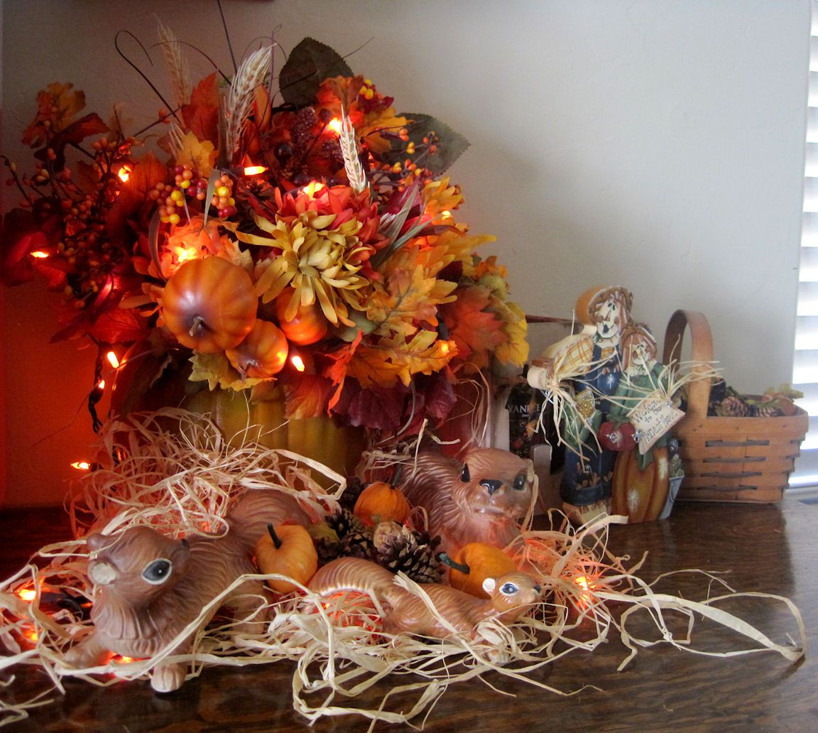 Wedding flower decoration images  Lovely Fall Table Centerpiece With Floral And Fruits Arrangements