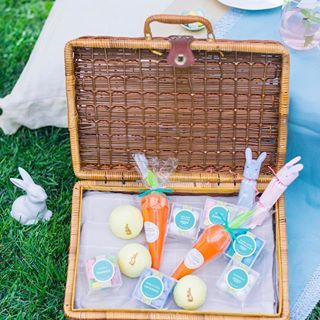 You didn't think we'd plan a picnic without a basket full of candy, did you?  Fluffy Bunnies, Golden Truffle Eggs, Easter Surprise Balls & Carrot Surprise treats make cheerful party favors & egg hunt prizes  Click the link in our bio to shop ☝#SweetSpringtime