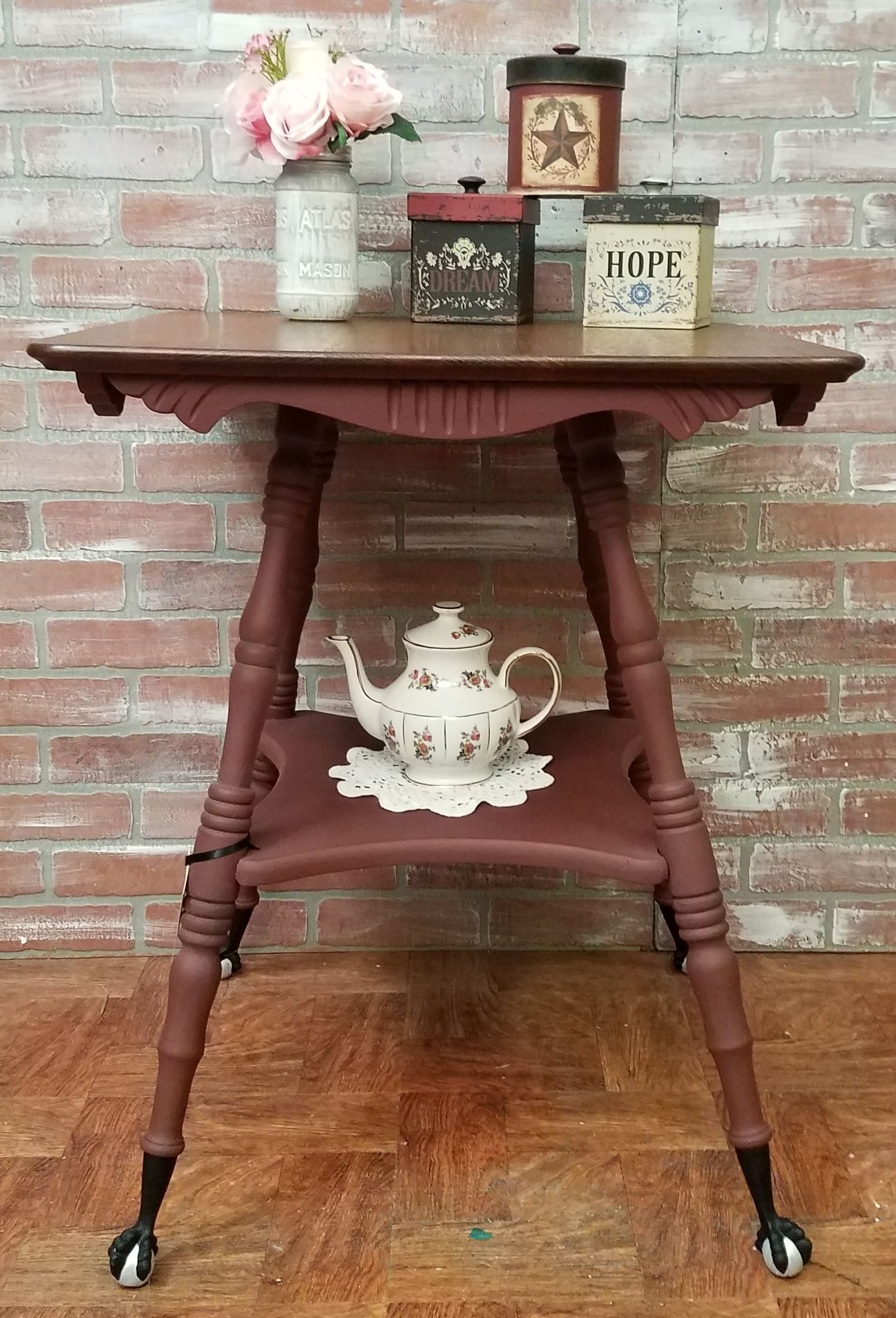 Oak parlor table with cash iron ball and claw feet