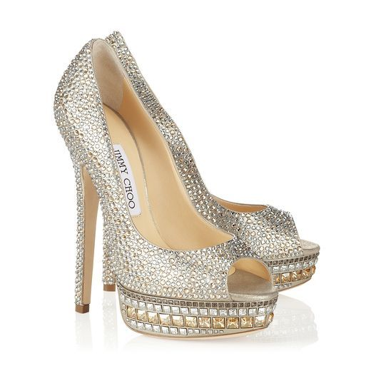 "Jimmy Choo Pumps--style appropriately named ""Kendall"" .....and they are perfect for me, tall, glittery, dramatic and over priced :)"