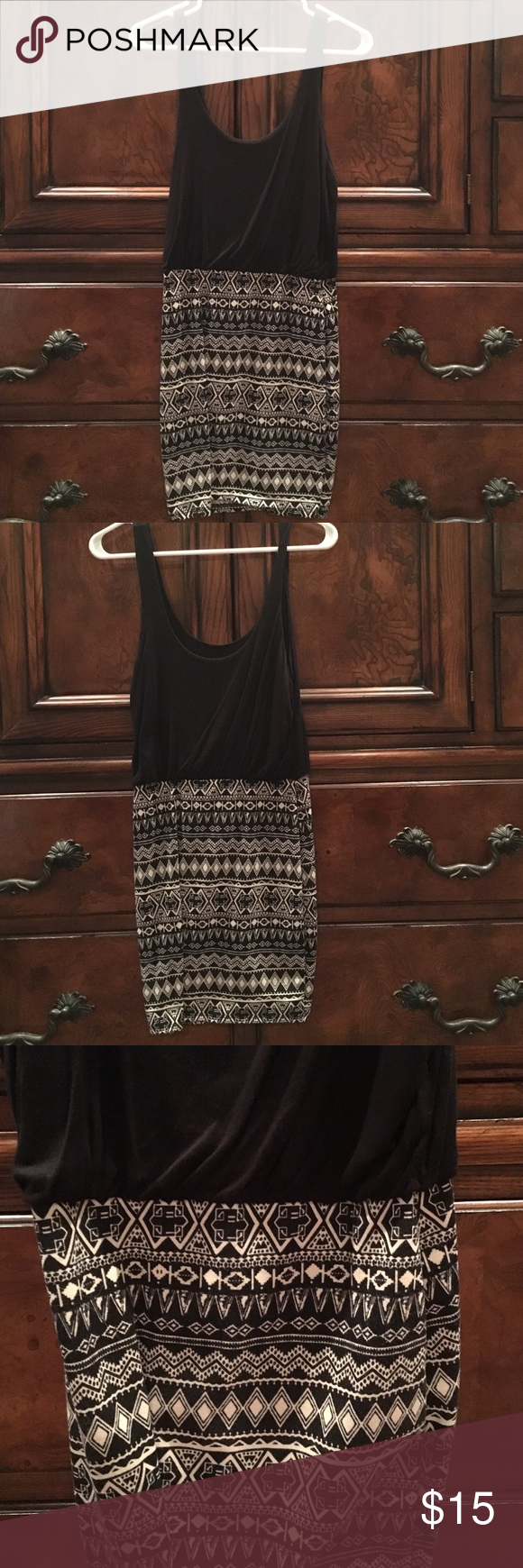 Black sleeveless dress Super cute and comfy black, tribal pattern sleeveless dress. 85% polyester 15% Rayon. Great with flats or heels. Kirra Dresses