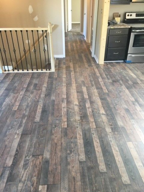 Light Grey Hardwood Floors Gray Tones Mixed With Light Creams And Tans Suggest A Floor Worn Grey Laminate Flooring Flooring Kitchen Flooring
