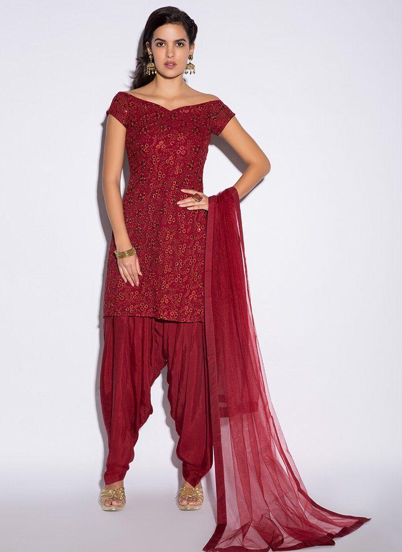 78c9235e7c Red Off Shoulder Punjabi Suit features a gorgeous georgette kameez  alongside a santoon inner and bottom. A net dupatta completes the look.
