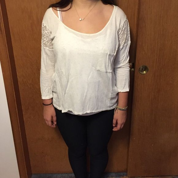 Long sleeve top Cream colored top with pocket on the front and lace back Forever 21 Tops Tees - Long Sleeve