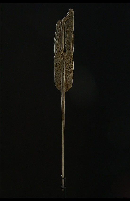 ROSSEL SPATULA - This elegant spatula comes from Rossel Island in the Eastern most part of the massim region. It has an excellent worn patina from generations of use. An almost identical to an example published in Harry Berans Betel Chewing equipment of East New Guinea as figure 49. Would date to the 1930's and measures 38 cm long