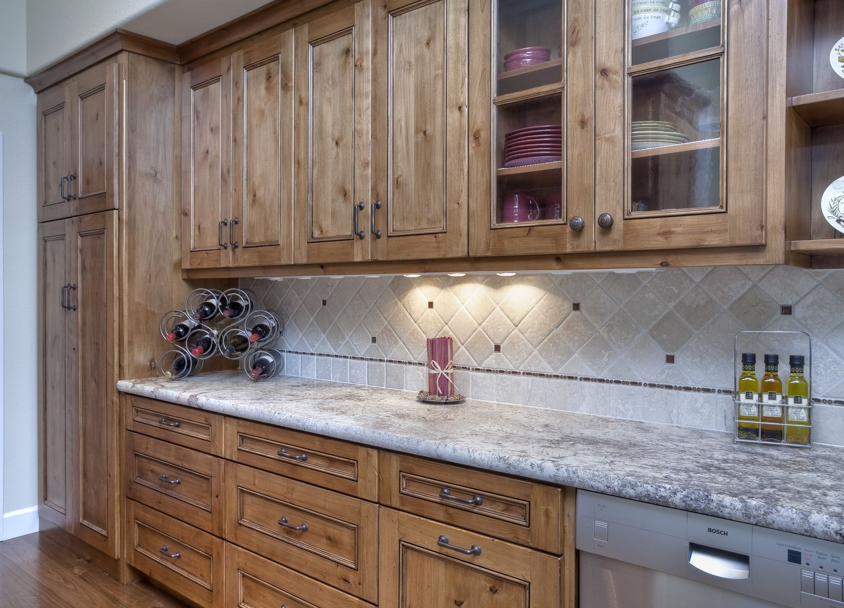 Rustic knotty alder kitchen with stain and glaze finish by for Rustic kitchen cabinets