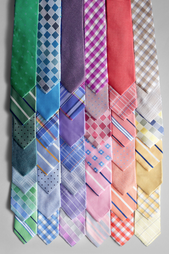 Colorful men's furnishings are just what he needs to tie his formal look together