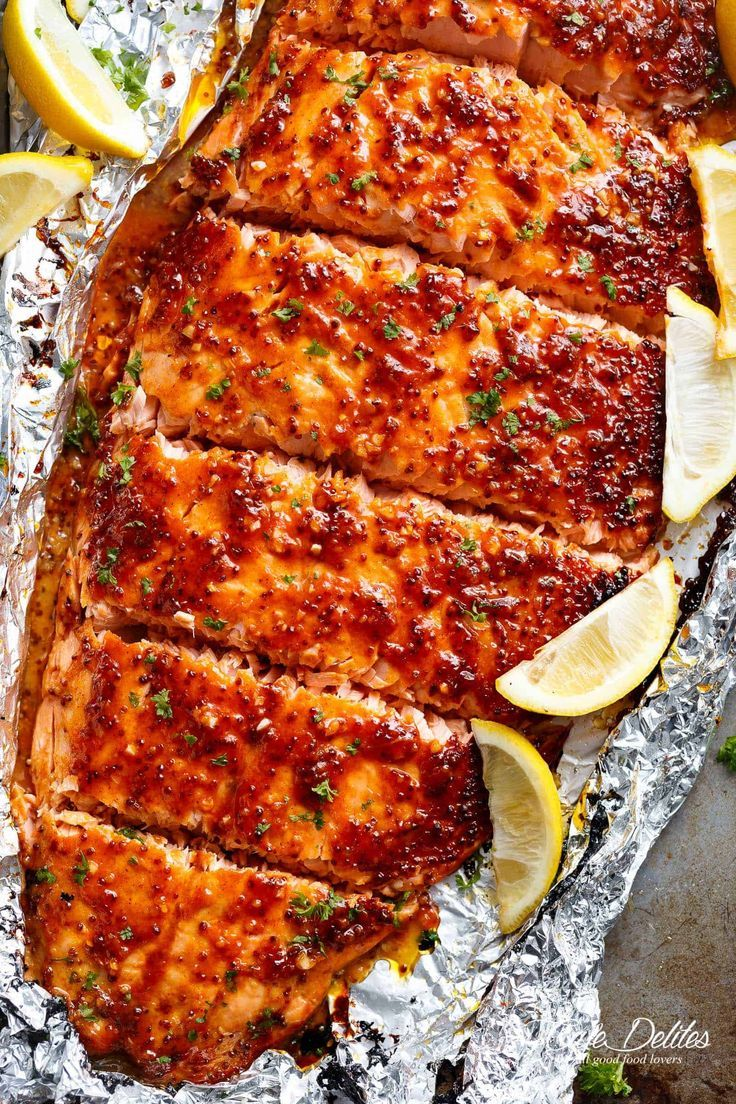 Garlic Butter Honey Mustard Salmon In Foil is a quick and easy salmon recipe, leaving you with no pans to wash and a juicy salmon for your dinner table! | cafedelites.com #salmonrecipes