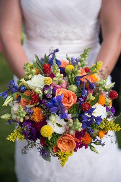 A colorful and charming bridal bouquet by Boulder Blooms.