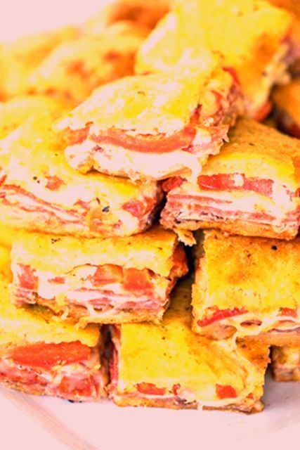 Appetizerrecipes #antipastosquares Antipasto Squares recipe - SO GOOD!! Crescent rolls stuffed with ham, salami, pepperoni, provolone, swiss, and roasted red peppers. then topped with a parmesan cheese, egg and pesto mixture and baked. These things are ridiculously good!!! There are never any leftovers when I take these to party! #appetizer #partyfood #crescentrolls #appetizerrecipes #antipastosquares Antipasto Squares recipe - SO GOOD!! Crescent rolls stuffed with ham, salami, pepperoni, provol #antipastosquares