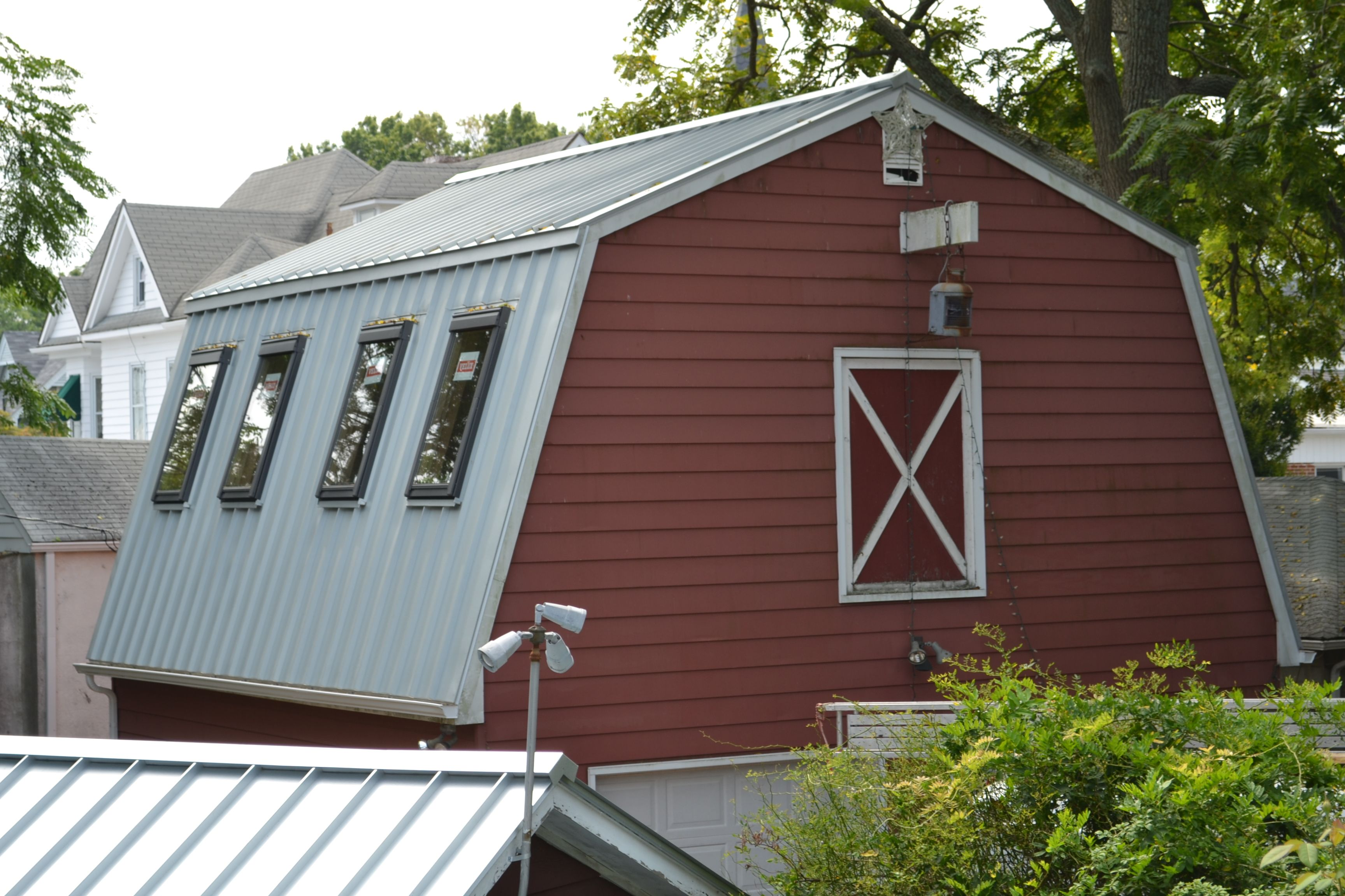 silver metal roof on mansard style barn ideas for the