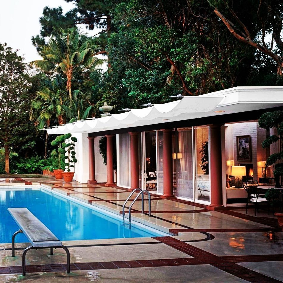 The pool area at Betsy and Alfred Bloomingdale\'s very stylish home ...