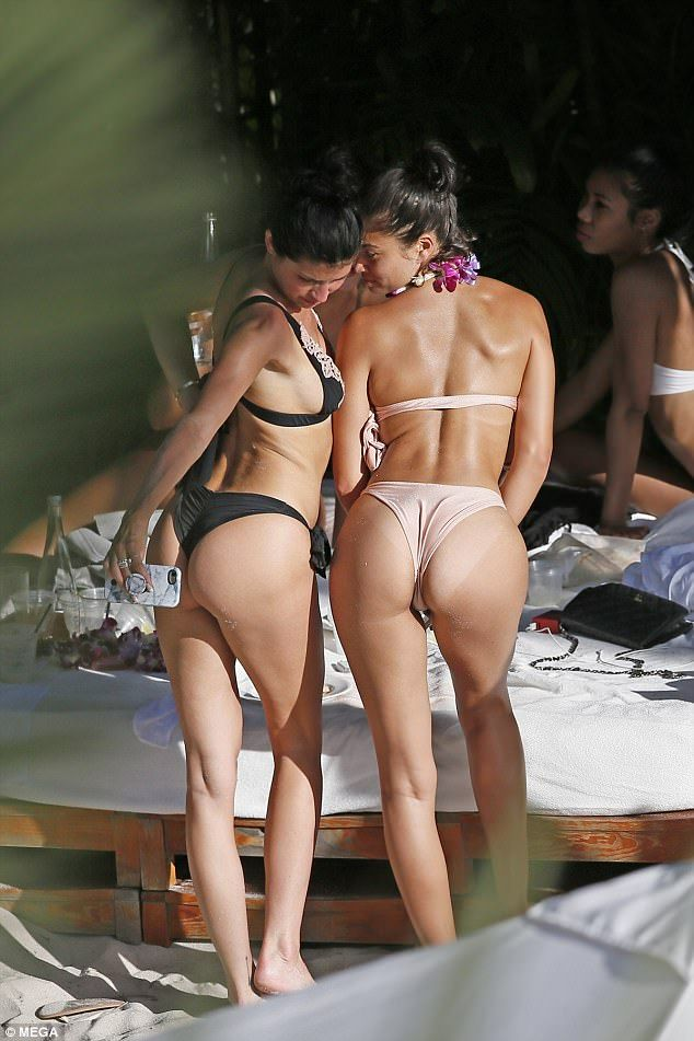 Girl bent over naked with g string on