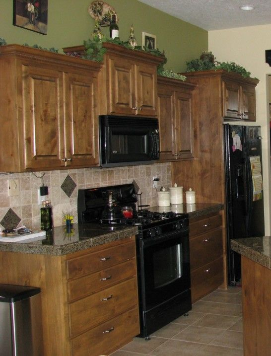 Sage green wall paint brown wooden kitchen cabinet and for Sage green kitchen cabinets with white appliances
