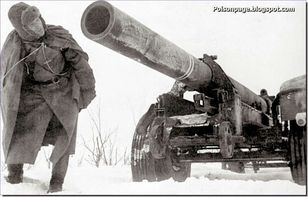 A curious Red Army soldiers looks at an abandoned German 1918 model, 210 mm gun. Stalingrad. 1943