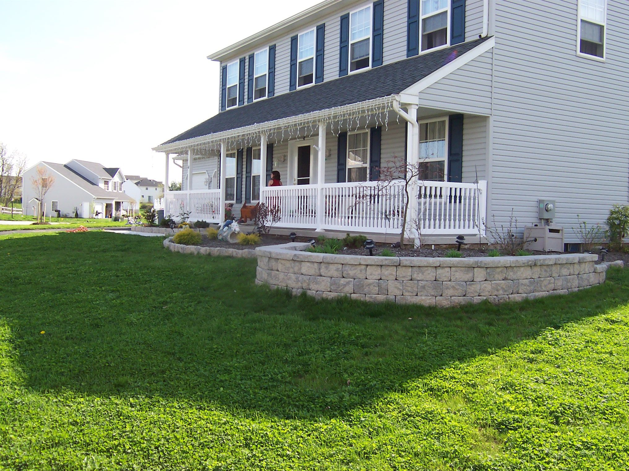 front yard walls | retaining wall was installed to create a raised