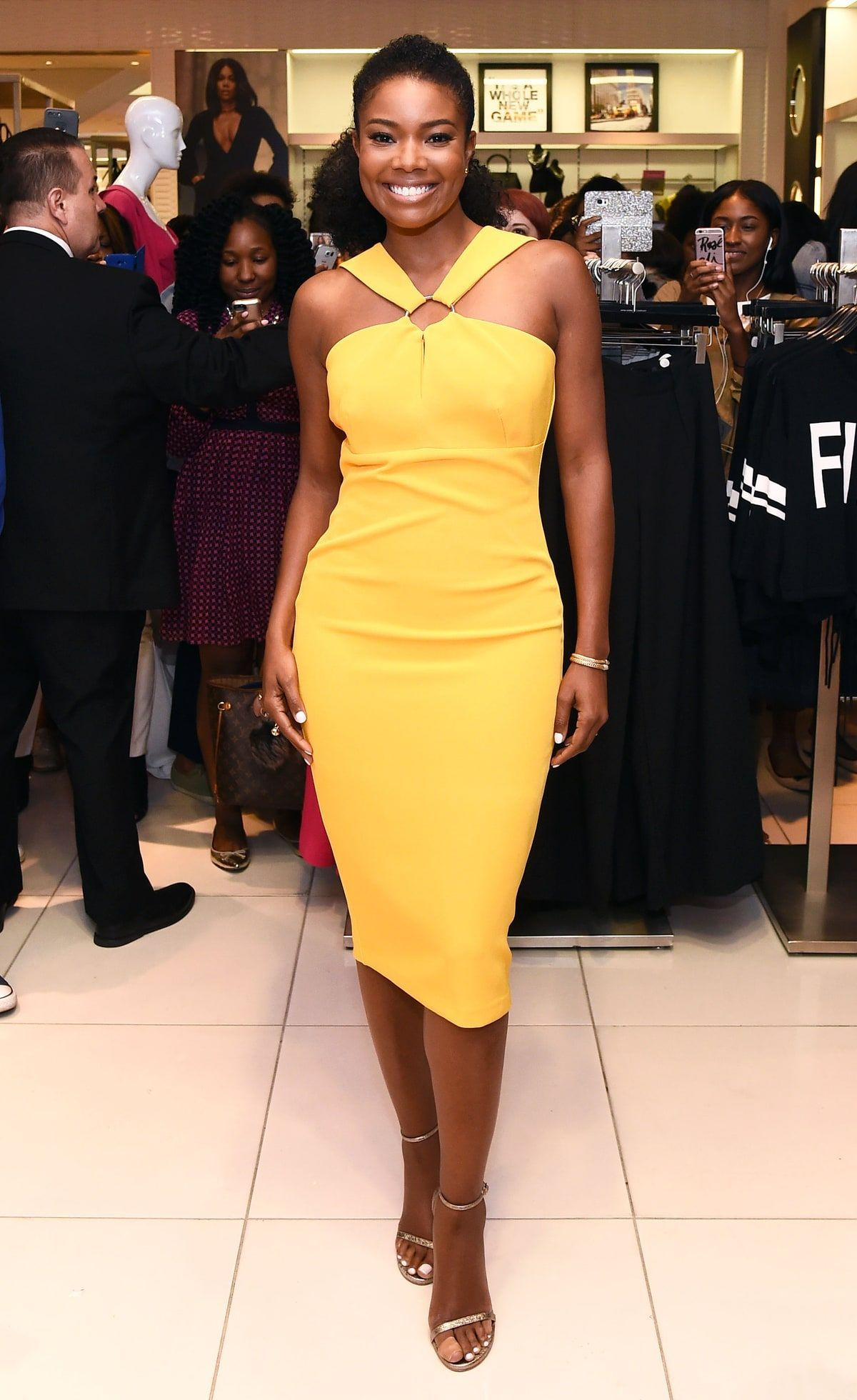 43ed0f44c5f Gabrielle Union In a yellow halter dress at the Gabrielle Union Collection  Launch at New York   Company in NYC on September 6