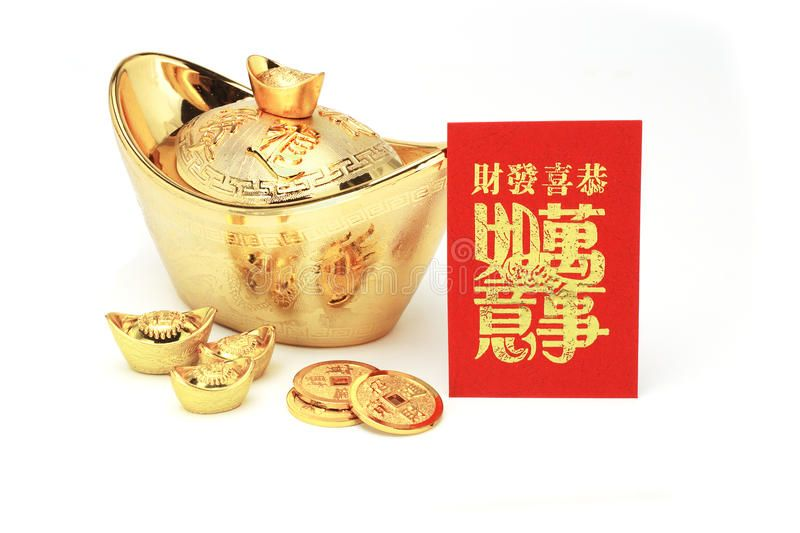 Chinese new year gold ingots and red packet. On white ...