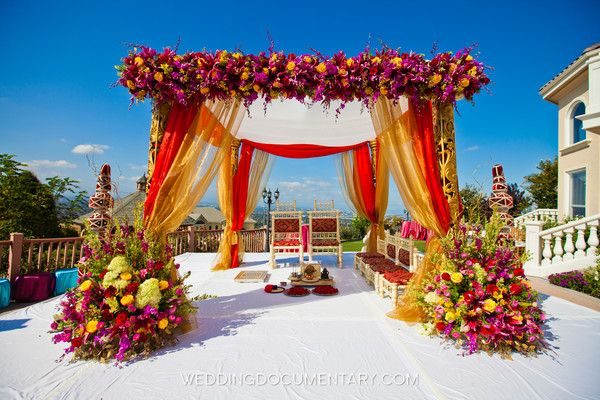 Red And Gold Drape Mandap With White Top And White Stage