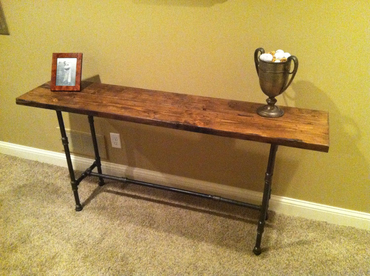 Great Reclaimed/Distressed Wood Black Iron Pipe Table. $300.00, Via Etsy.