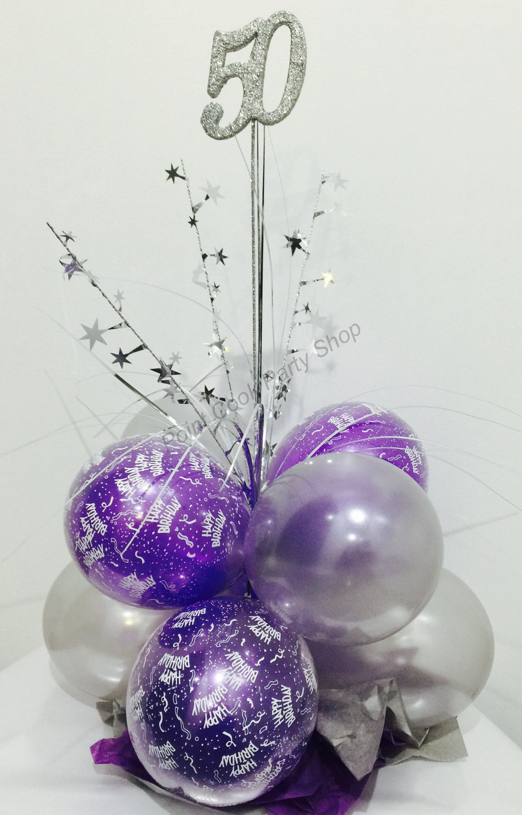 Th birthday balloon table centerpiece in purple and