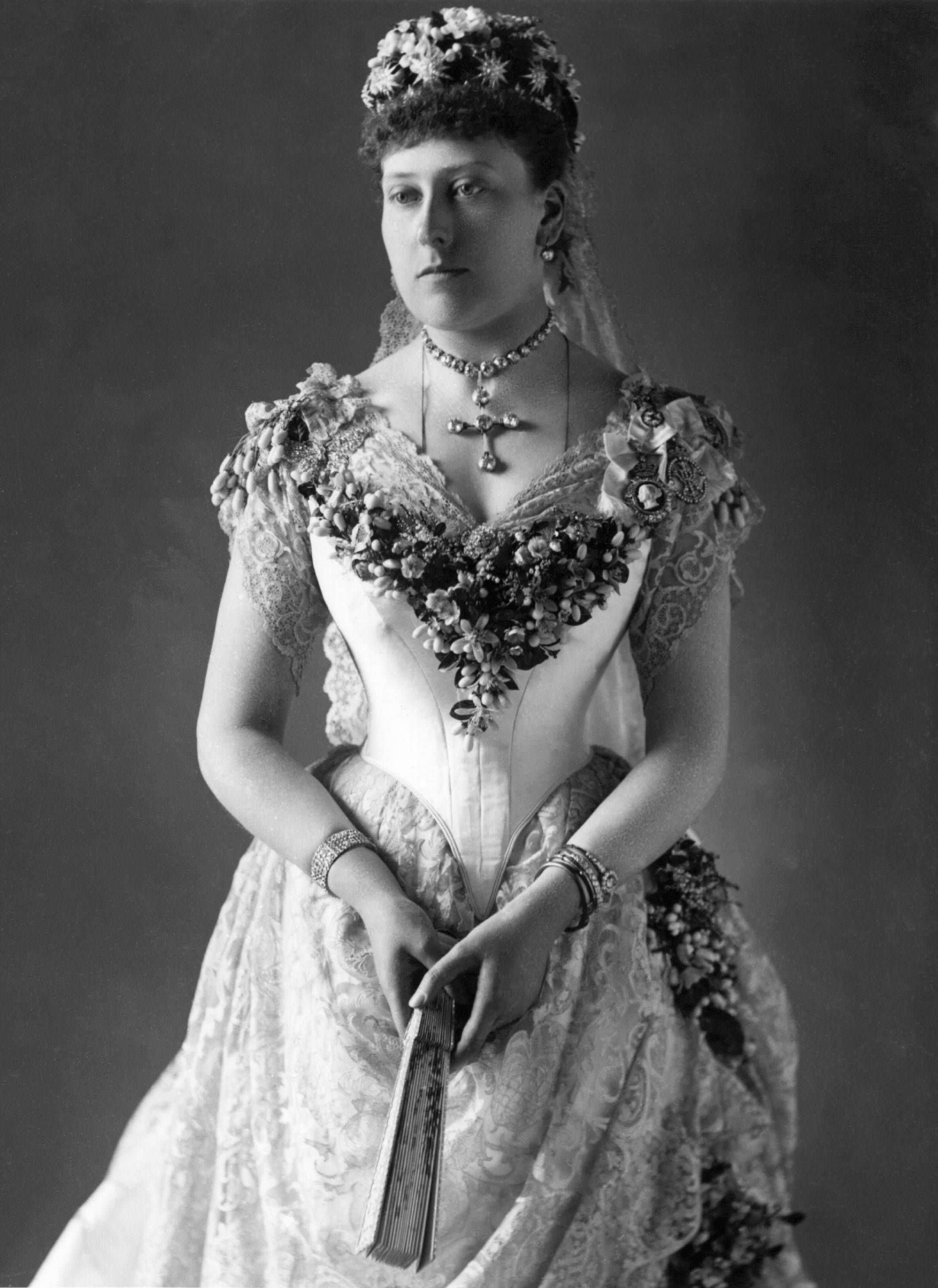 1885 Princess Beatrice posing in her wedding dress