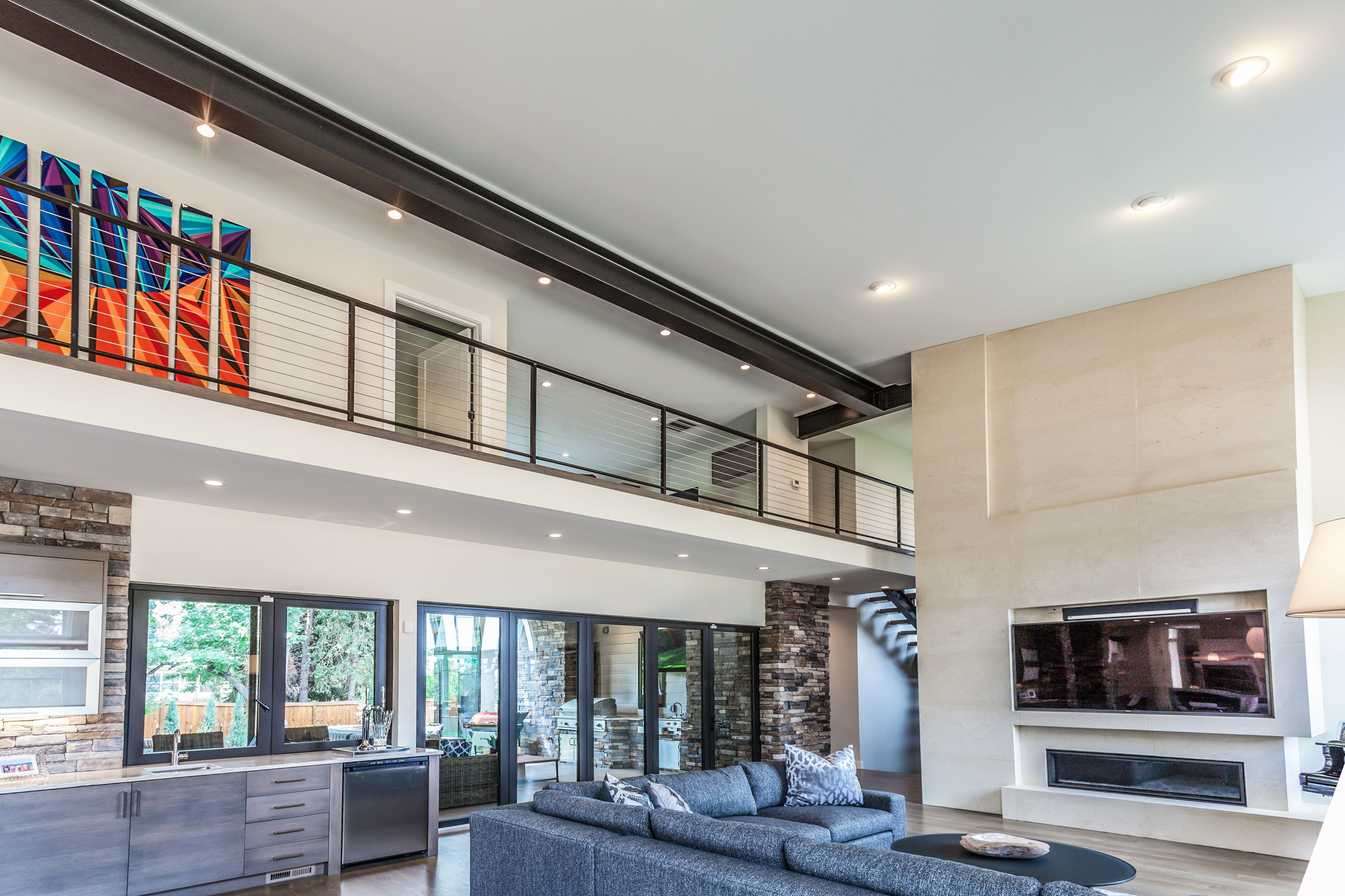 The Living Room Of This Modern Home Is Filled With An Abundance Of Natural Light Residential Architect Home Builders House Styles