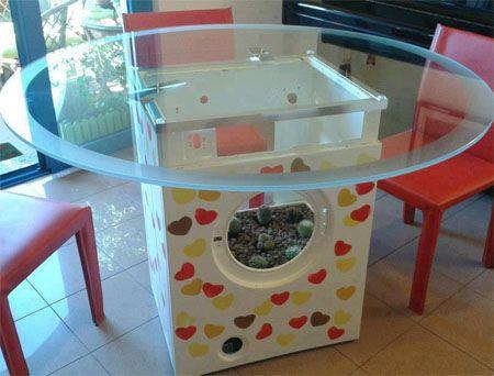 Carcaza de lavarropas usada como mesa y macetero