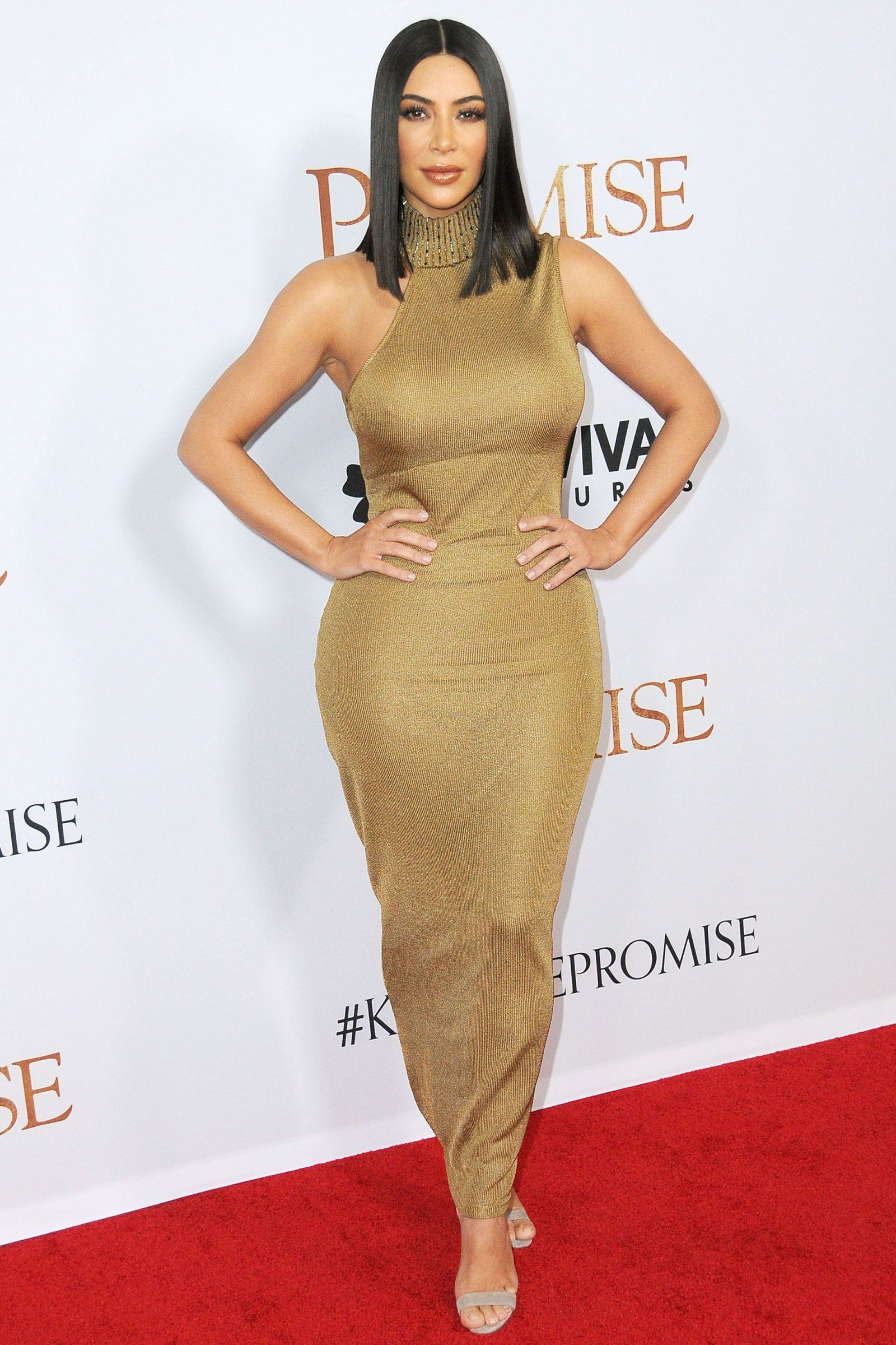 Kim Kardashian Stuns in a Bright Yellow Vintage Versace Corset Dress