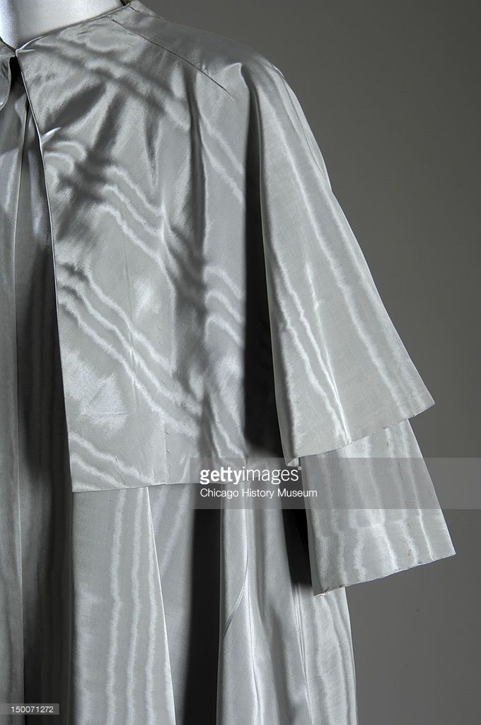 Evening coat, ca 1950 (front partial view of shoulder). Silk moire by Cristobal Balenciaga.