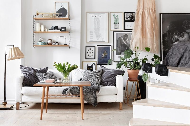 The layout of this flat is kinda fun - the bedroom sits on a small platform above the living room, which is accessible by a little staircase and also houses a hidden closet. I'm not totally sure I could live with a black kitchen, but the living room I could quite happily transplant into my flat tomo
