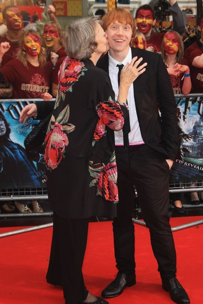 a56581817294 Maggie Smith gives Rupert Grint a kiss as they arrive for the World Premiere  of Harry