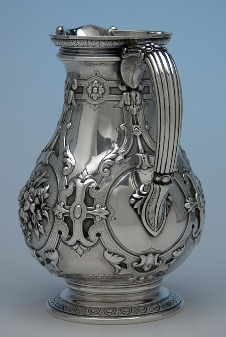 William Gale for Tiffany & Co Antique Sterling Silver Pitcher, c. 1850's Bold decoration and wonderful design combine to make this pitcher an exquisite example of early Tiffany silver made by William Gale. Attached at the side is a c-shaped reeded handle with acanthus leaf terminals. Chased leaves decorate the spreading, pedestal foot and the underside of the top rim. Ornamenting the body is boldly executed renaissance inspired strap-work with fine engraving. Incorporated into this ...