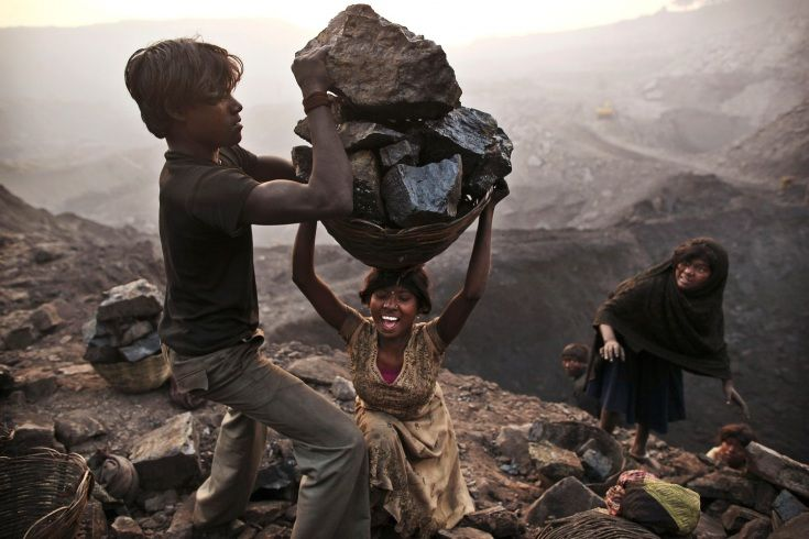 Kevin Frayer—AP  January 6, 2011. A young woman stumbles as she tries to carry a large basket of coal while illegally scavenging at an open-cast mine in Bokapahari, India.      Read more: http://lightbox.time.com/2011/12/31/lightbox-365-a-year-in-photographs/#ixzz1nxBWRe9q