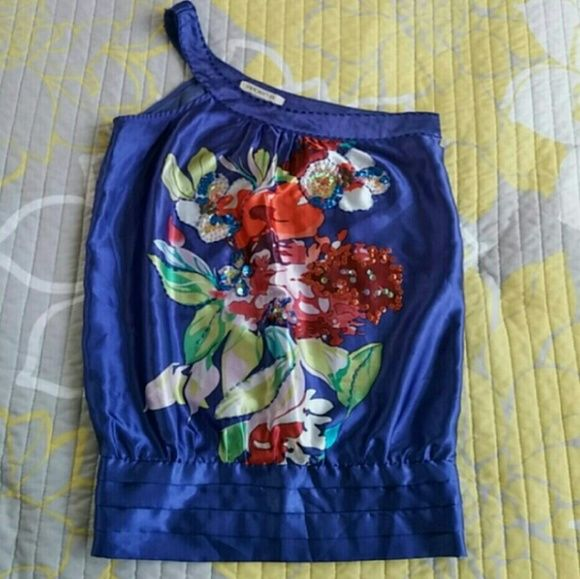 """GONE 10/1 ⏰ Purple One Shoulder Flower Sequin Top 🎀25% Off Bundles🎀  This top is so vibrant! It shines w/beaded & sequin accents on a beautiful flower design splashed with orange, red & yellow. Banded smocked waist. Silky satin fabric. This top stretches at the elastic waist band but the body has no stretch.  Some beads & sequins are loose but nothing that is really noticeable or affects the design. Price reflects.   { Measurements } Underarm to Underarm: 16"""" Waist: 15""""  Underarm to Hem…"""