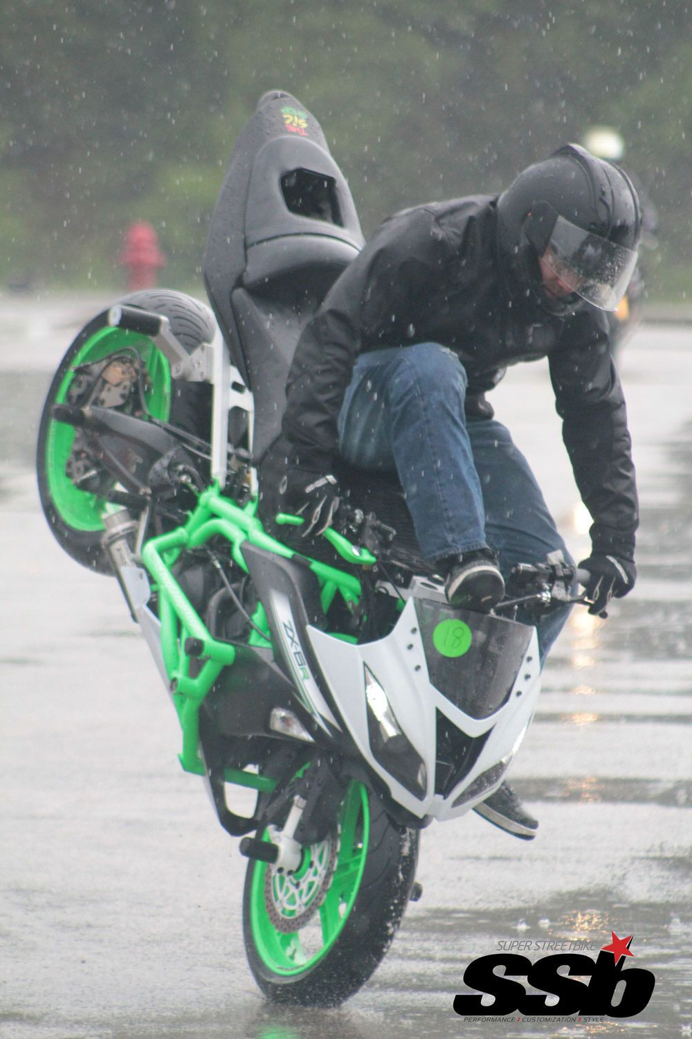 Tony Perez pulls off a high chair stoppie in the pouring rain during Speed and Strength Pro Freestyle practice.