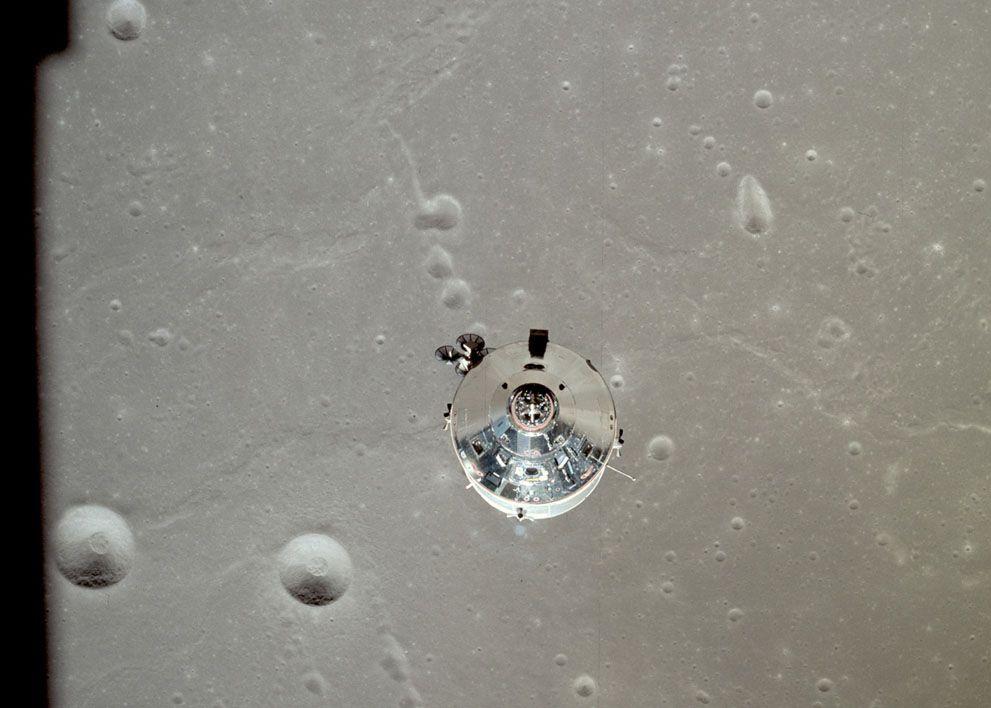 "CSM ""Columbia"" over Craters Taruntius K, Taruntius P, and Dorsum Cayeux (in Mare Fecunditatis). Partially visible are craters Anvil and Taruntius H. (NASA)"