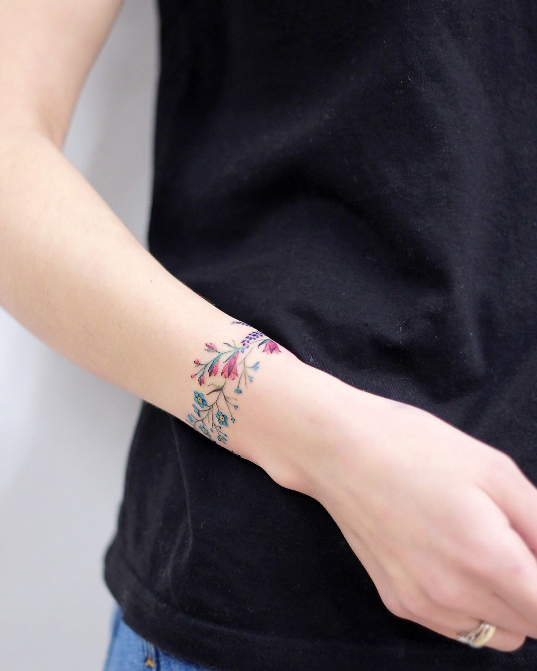 Check out latest bracelet tattoo style on wrists for charm
