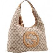 The tan leather trimmings and Gucci logo add an elegant touch to this useful and spacious Gucci Monogram Canvas hobo