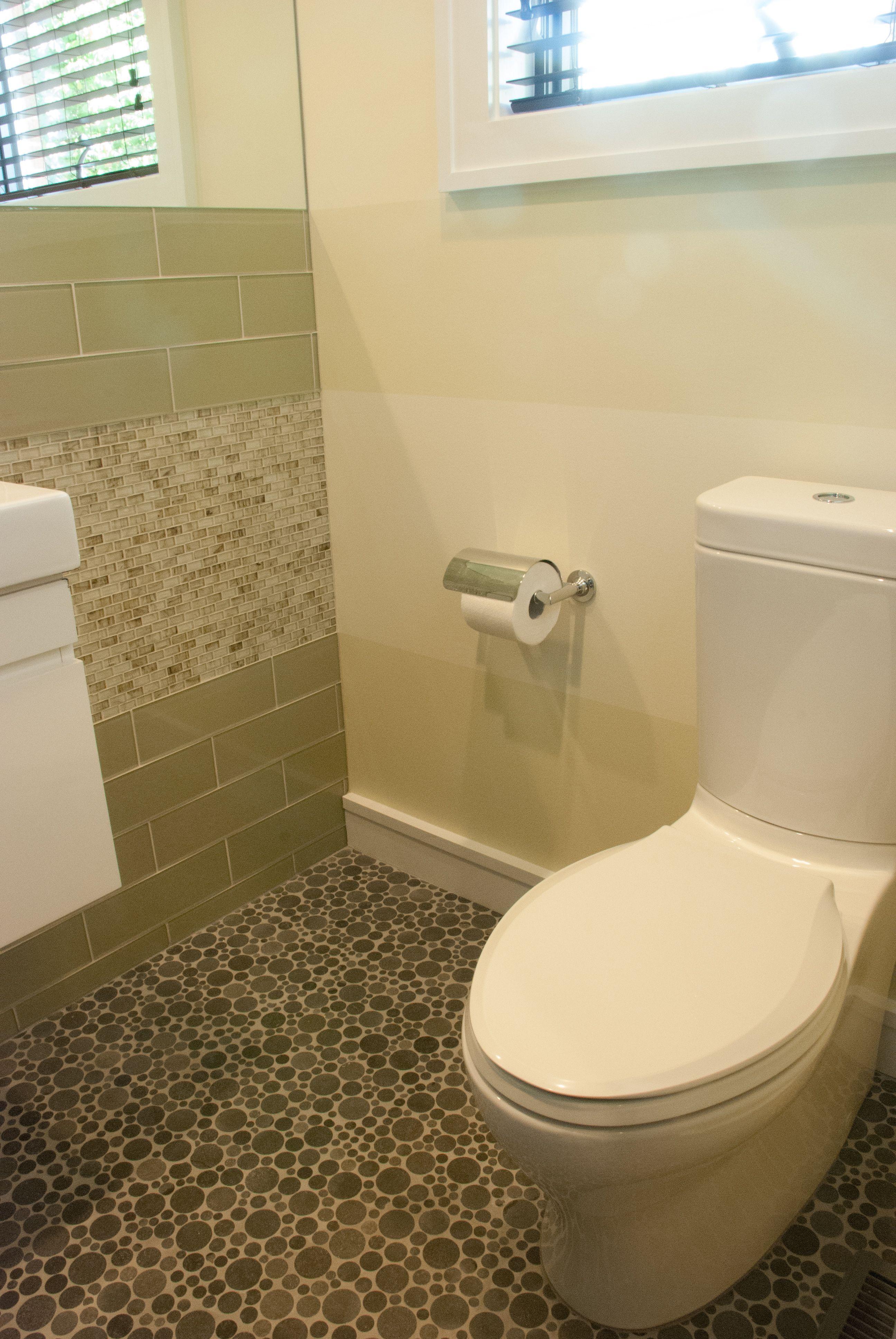 Lovely tiled powder room designed by Christine Zondervan Interiors ...