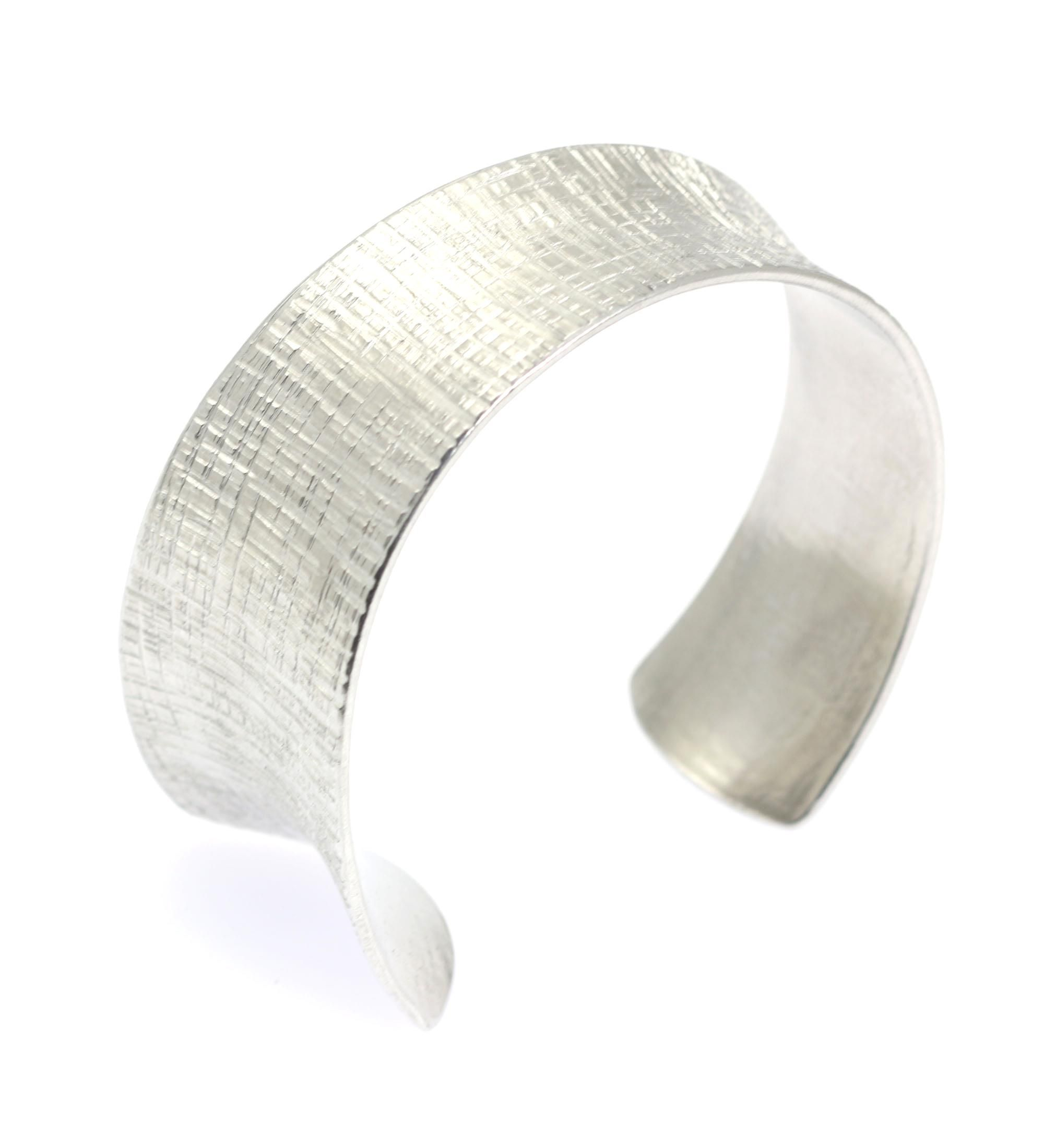 off best tapered linen anticlastic silver tone bangle bracelet