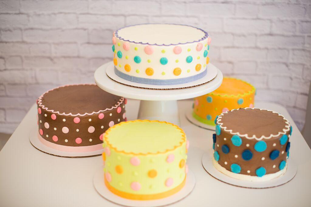 Buttercream Polka Dots on buttercream iced cakes
