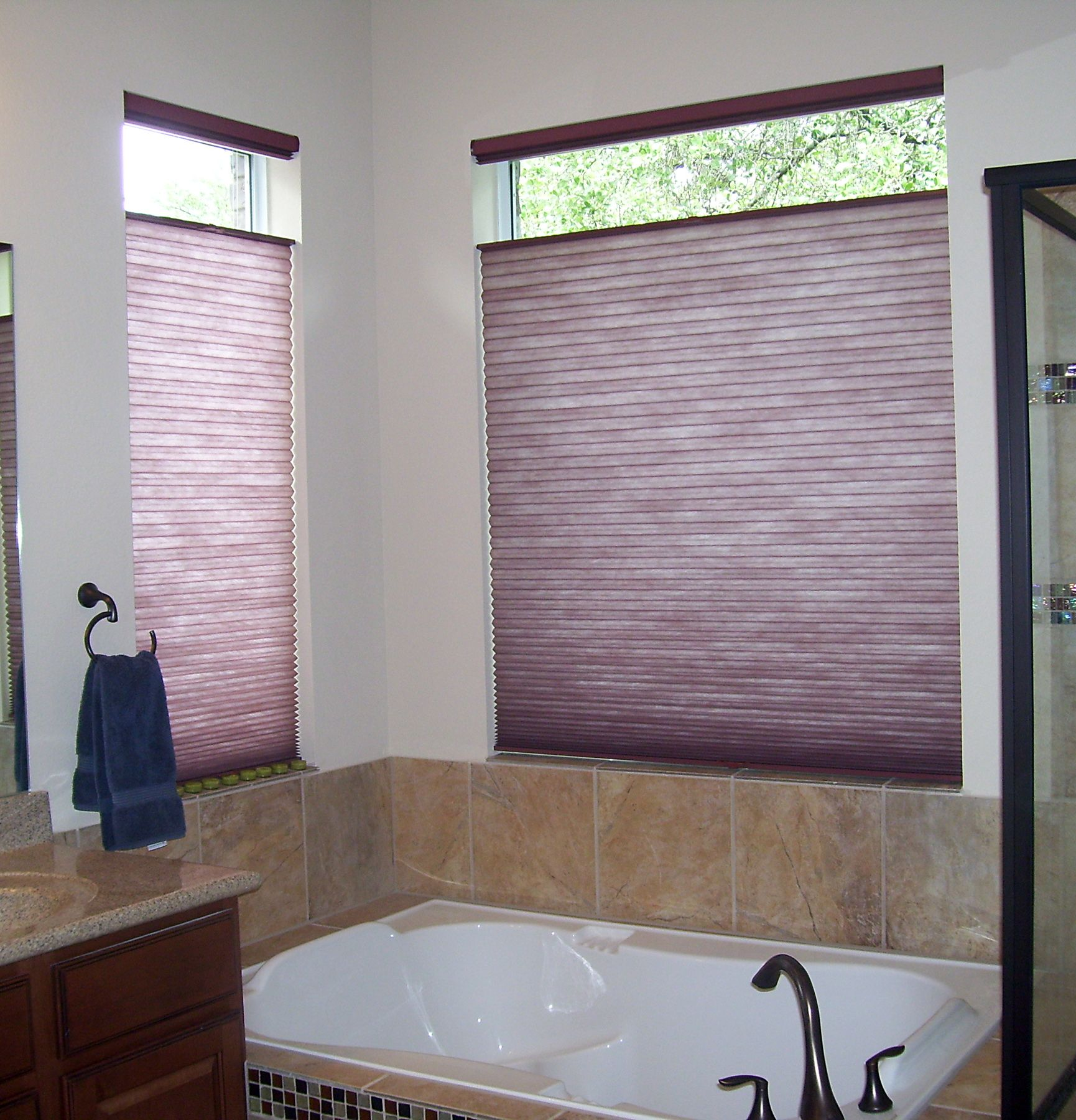 After photo of bathroom with honeycomb shades great for privacy light control and energy for Bathroom window treatments privacy