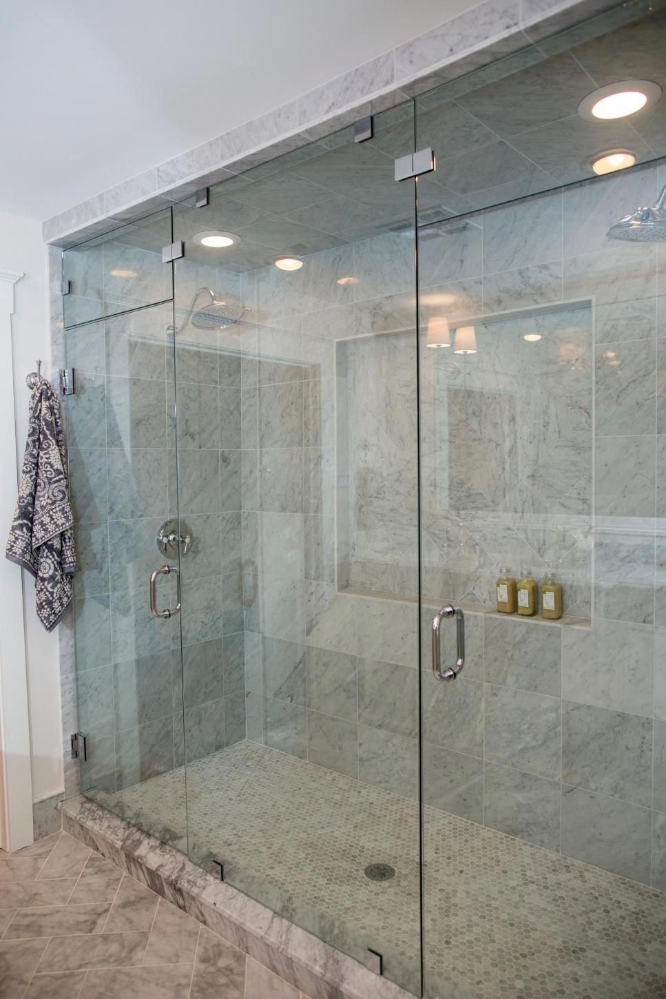 A Close Up Of The Shower In The Newly Remodeled Master Bathroom In