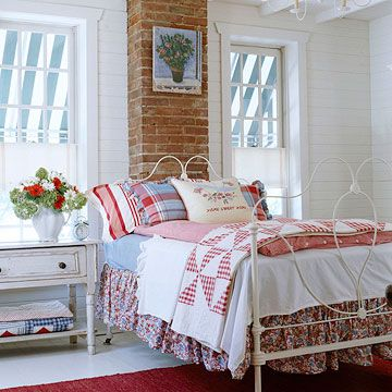 Cozy Country Bedroom    Create a focal point with a bed dressed in eclectic linens. Here, a mix of prints and solids is unified by the use of apple red, denim blue, and crisp white hues.